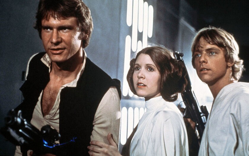 """From left: Harrison Ford, Carrie Fisher and Mark Hamill in a scene from the 1977 space epic """"Star Wars."""""""