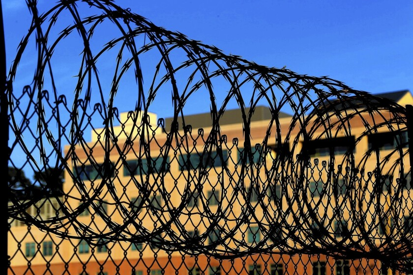 Razor wire encircles the exercise yard at San Quentin.