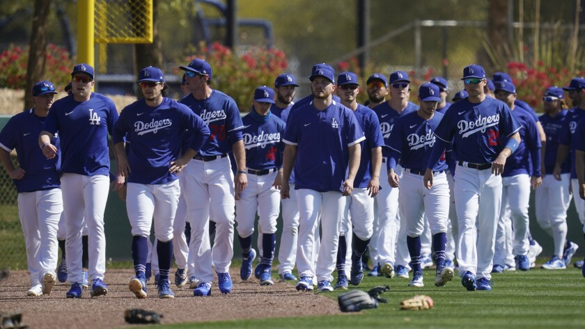 Dodgers players walk back to the infield after running sprints.