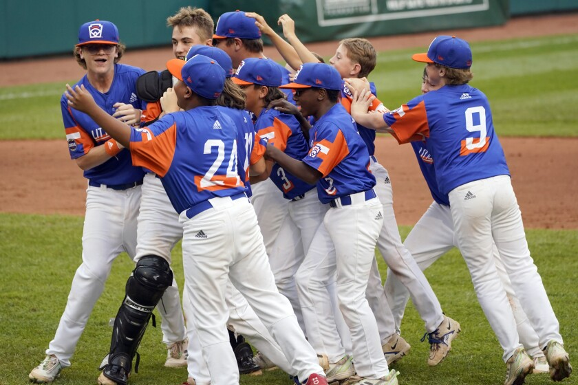 Taylor, Mich. players celebrate their win over Hamilton, Ohio, in the Little League World Series Championship.