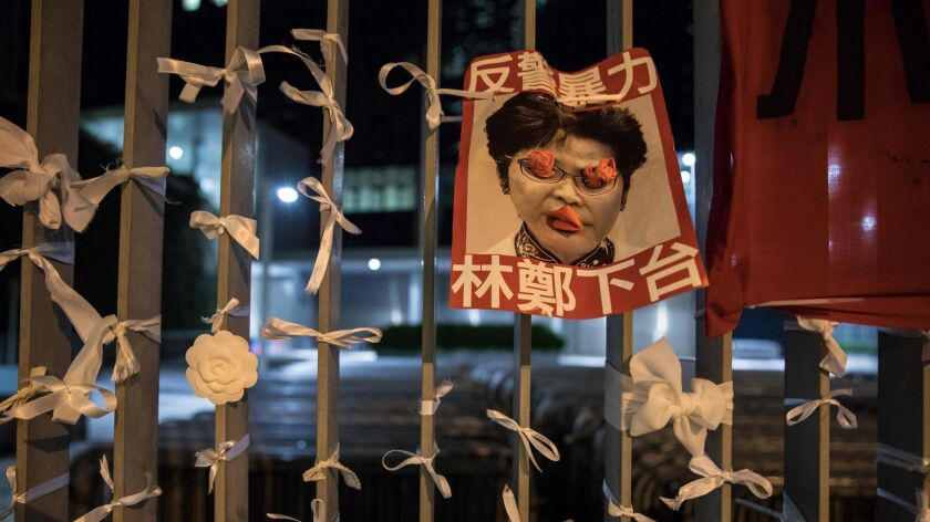 A poster bearing an image of Hong Kong Chief Executive Carrie Lam is displayed outside the government headquarters after a rally against an extradition bill Monday.