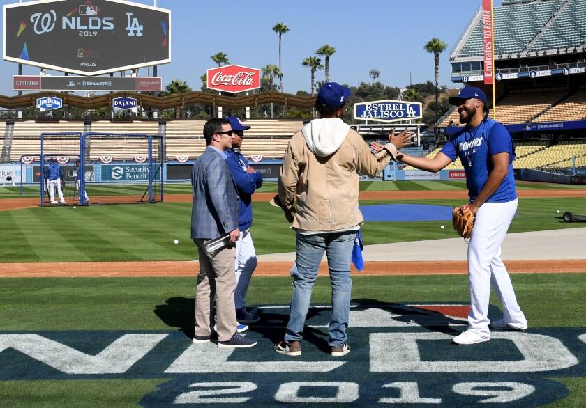 Dodgers closer Kenley Jansen greets former Dodgers outfielder Matt Kemp.