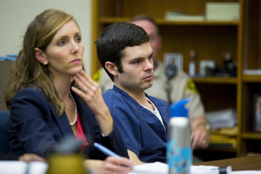 Kevin Bollaert sitting with his attorney, Deputy Public Defender Emily Rose-Weber, listen to the reading of his 18-year sentence given to him by San Diego Superior Court Judge David Gill.
