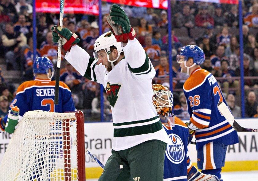 Minnesota Wild's Jason Pominville (29) celebrates a goal against the Edmonton Oilers during the first period of an NHL hockey game Thursday, Feb. 18, 2016, in Edmonton, Alberta. (Jason Franson/The Canadian Press via AP)