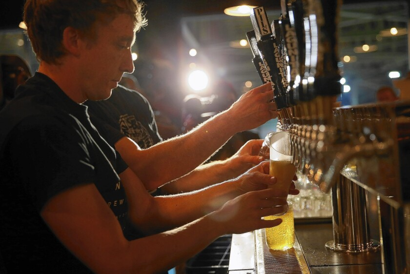 """Craft beer flows in the Lagunitas tap room. The company is at its """"maximum growth threshold here in California because of water,"""" said Leon Sharyon, the craft brewer's chief financial officer."""