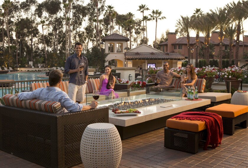 The outdoor poolside fireplace at The Village Mission Valley Apartment Homes is one of many points on the property where residents can mingle with one another. The community vibe is strong here.