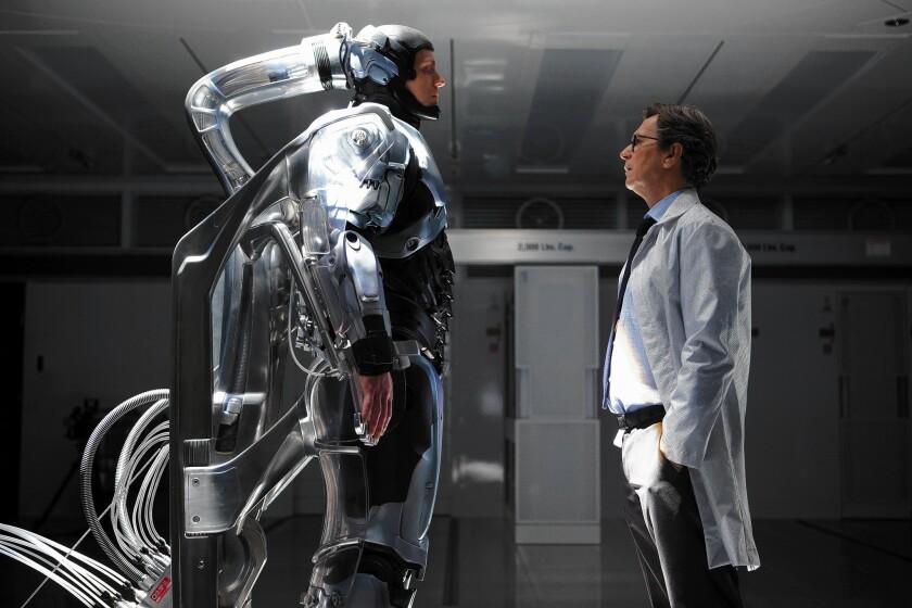 "Joel Kinnaman, left, and Gary Oldman star in ""RoboCop."""