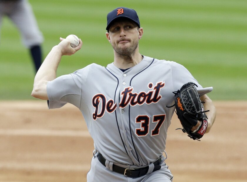 Detroit Tigers starter Max Scherzer throws against the Chicago White Sox during the first inning of a baseball game in Chicago on Wednesday, April 30, 2014. (AP Photo/Nam Y. Huh)