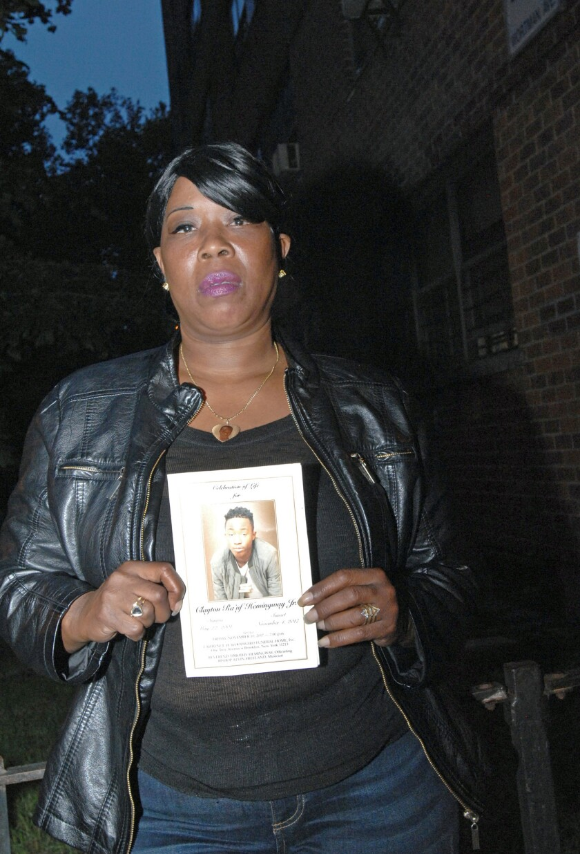 Dionne Boyd holds a photo of her son Clayton Hemmingway, who was shot and killed in November of 2017. NYPD was unable to identify her son's killers due to non-functioning security cameras.