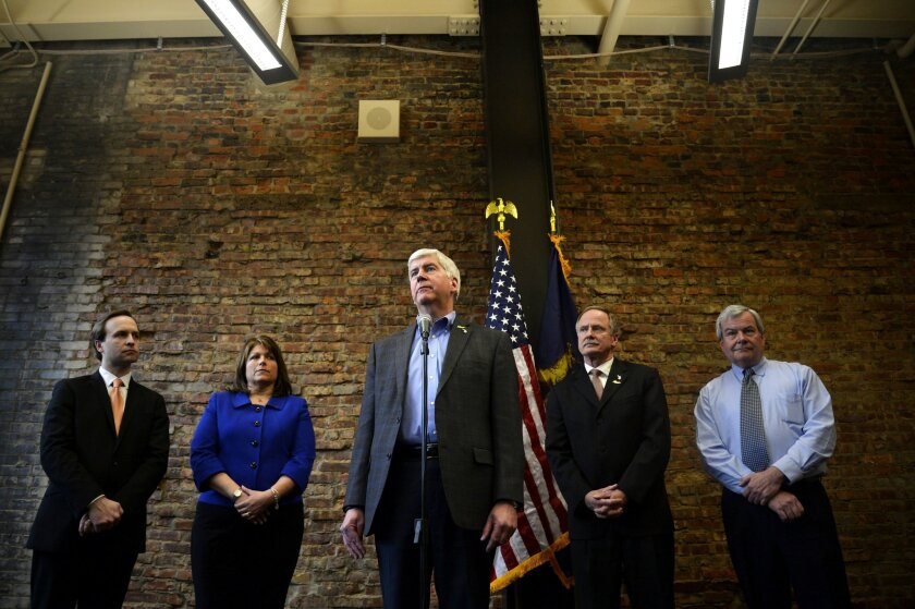 Gov. Rick Snyder reacts while answering questions during a press conference on Wednesday, Feb. 17, 2016, at Rowe Professional Services in Flint, Mich. Snyder announced next steps to identify and replace high-risk, high-priority pipes in Flint. Rowe Professional Services will be conducting tests to