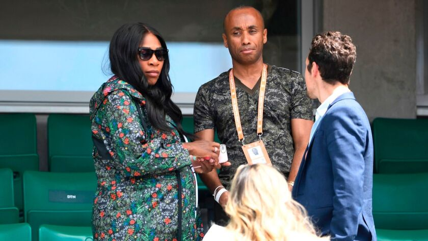 US Serena Williams (L) leaves after attending her sister US Venus Williams' tennis match against Jap