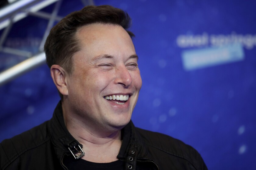 Elon Musk smiles at a red-carpet event in Berlin on Dec. 1.