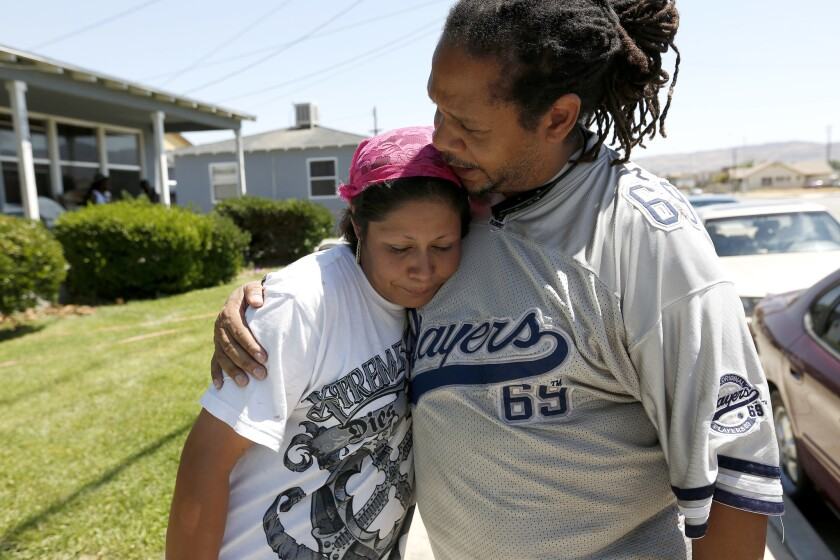 Roberta Alcantar, mother of the victim, is comforted by Pharaoh Mitchell