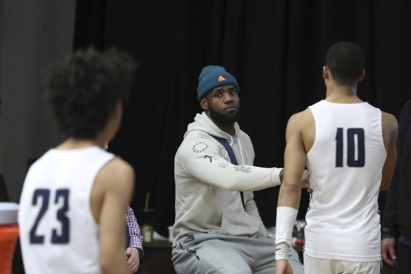 Lakers star LeBron James greets Sierra Canyon players after their loss to Fairfax (Va.) Paul VI at the HoopHall Classic on Monday in Springfield, Mass.