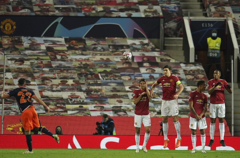 Basaksehir's Aziz Behich scores his side's first goal during the Champions League Group H soccer match between Manchester United and Istanbul Basaksehir at Old Trafford in Manchester, England, Tuesday, Nov. 24, 2020. (AP Photo/Dave Thompson)