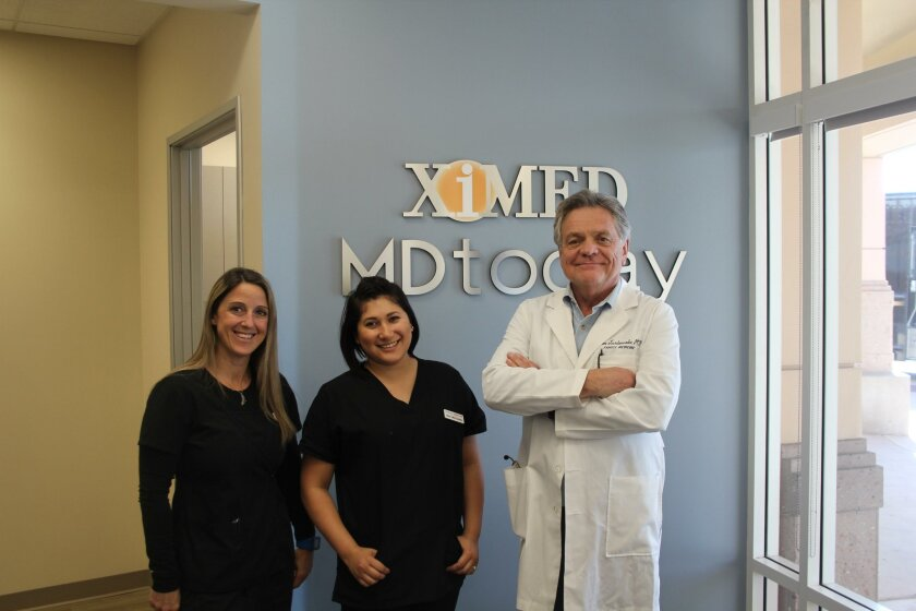 Dr. Len Jurkowski, medical director of MD Today Urgent Care with medical assistant and x-ray technician Tina Juaire and Bianca Blazer, patient coordinator.