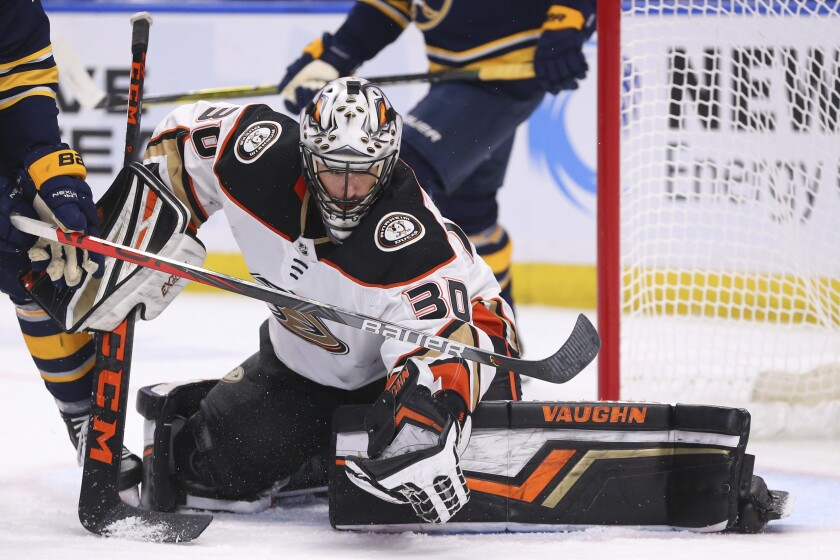 Ducks goalie Ryan Miller makes a glove save during the third period of the Ducks' 3-2 win Sunday over the Buffalo Sabres.