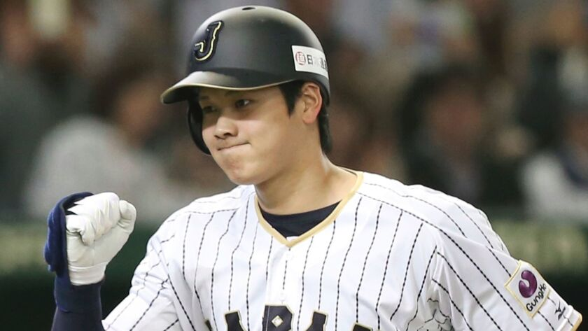 Japan's Shohei Ohtani reacts after hitting a solo home run against the Netherlands during an international exhibition series baseball game at Tokyo Dome on Nov. 12, 2016.