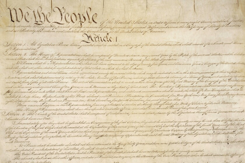 A portion of the first page of the U.S. Constitution.