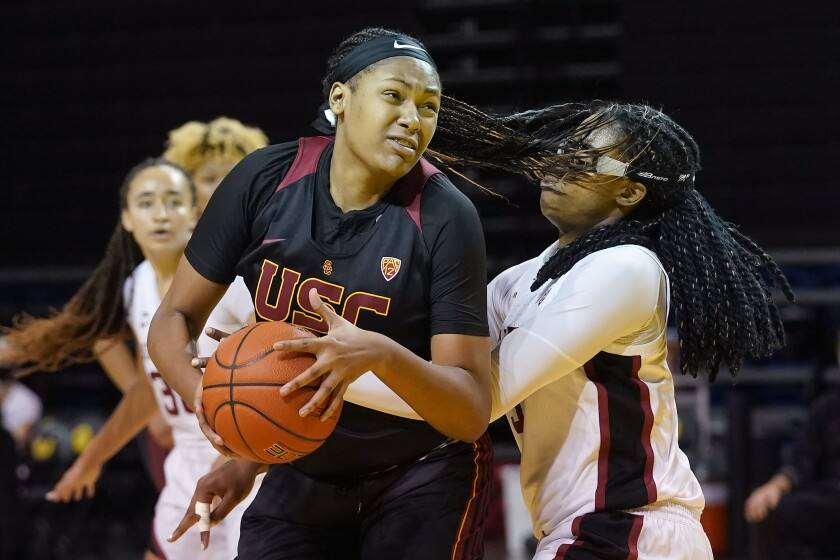 USC center Angel Jackson is defended by Stanford forward Francesca Belibi.