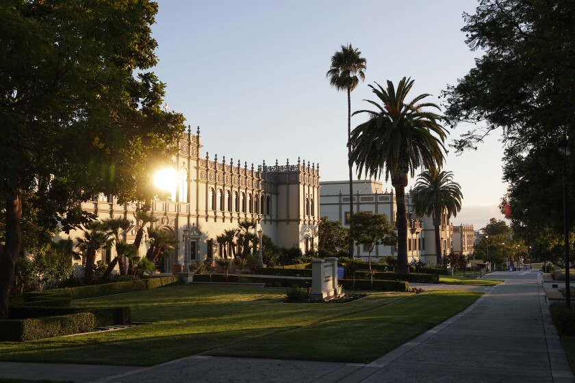 Sunlight reflects off windows of a building on the University of San Diego campus