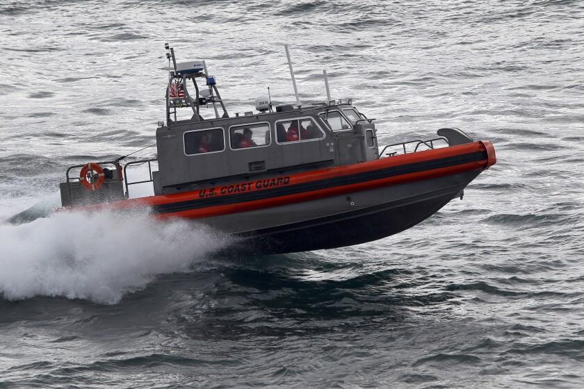 A U.S. Coast Guard multi-mission boat, the CB-OTH-4, plies the Arctic waters off the coast of Barrow, Alaska.
