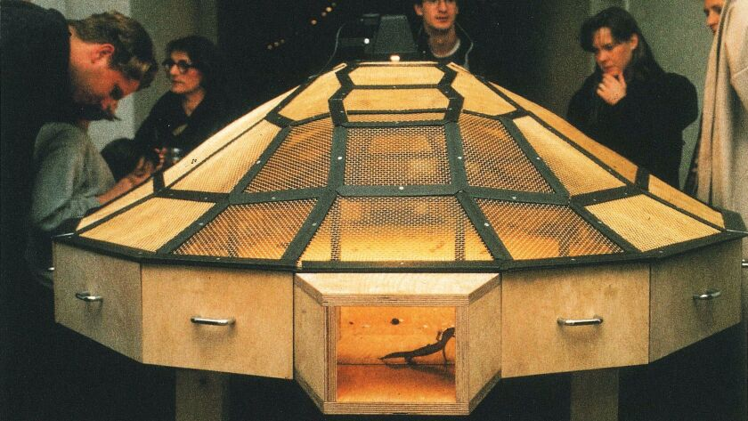 Huang Yong Ping'S Theater of the World, 1993. Wood and steel structure with wire mesh, warming lamps