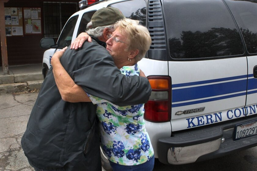 Annette Scates hugged fellow Shriner Bob Strangman, the caretaker at the Al Bahr Temple Shrine camp who was the last person out of the camp about 2pm Monday minutes before fire swept through the facility.