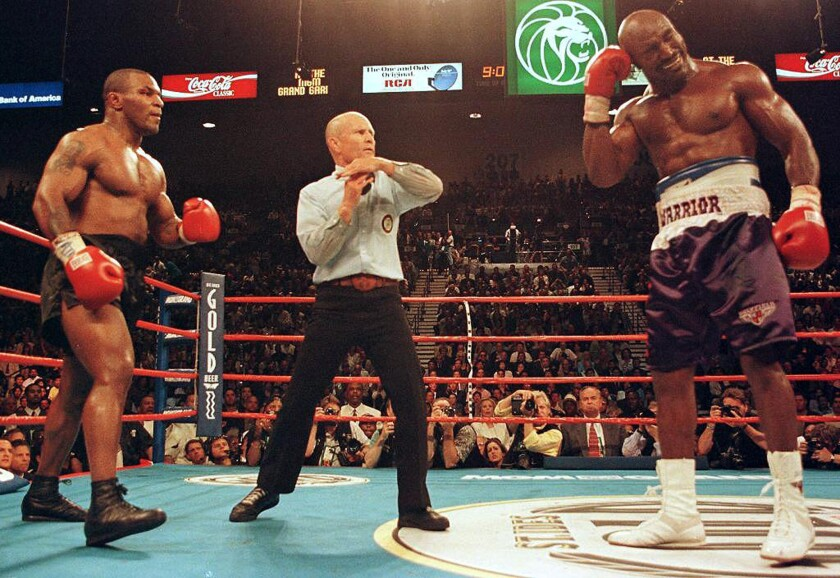 Referee Lane Mills (C) stops the fight in the thir