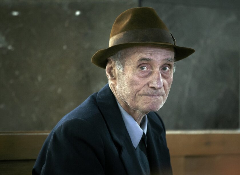 FILE - This is a Wednesday, Nov. 25, 2015 file photo of former communist prison commander Alexandru Visinescu, 90, as he waits for his hearing to start at an appeals court in Bucharest, Romania. Prosecutors at Romania's top appeals court on Wednesday Jan. 27, 2016 called for a 20-year sentence for Alexandru Visinescu, a communist-era prison commander convicted of crimes against humanity for the deaths of 12 political prisoners. (AP Photo/Vadim Ghirda, File)