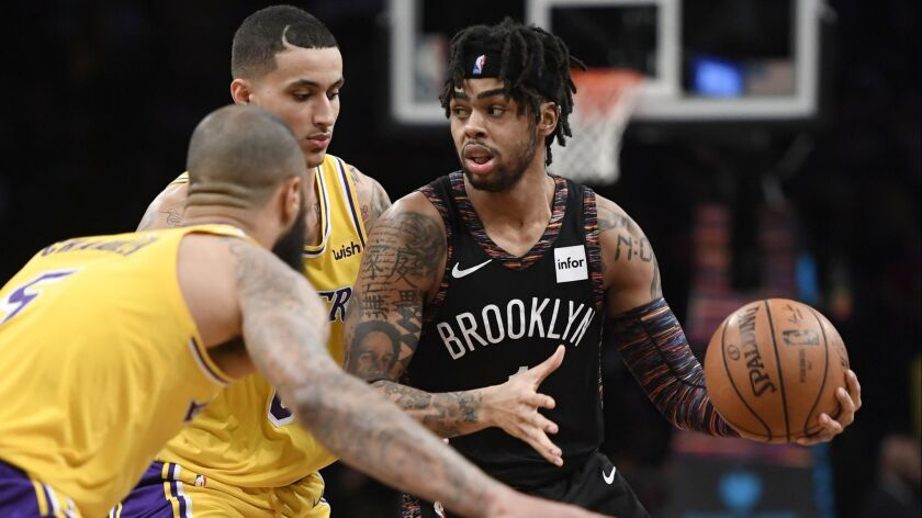 D'Angelo Russell of the Brooklyn Nets dribbles around the Lakers' defense during the third quarter of their game at Barclays Center on Dec. 18.