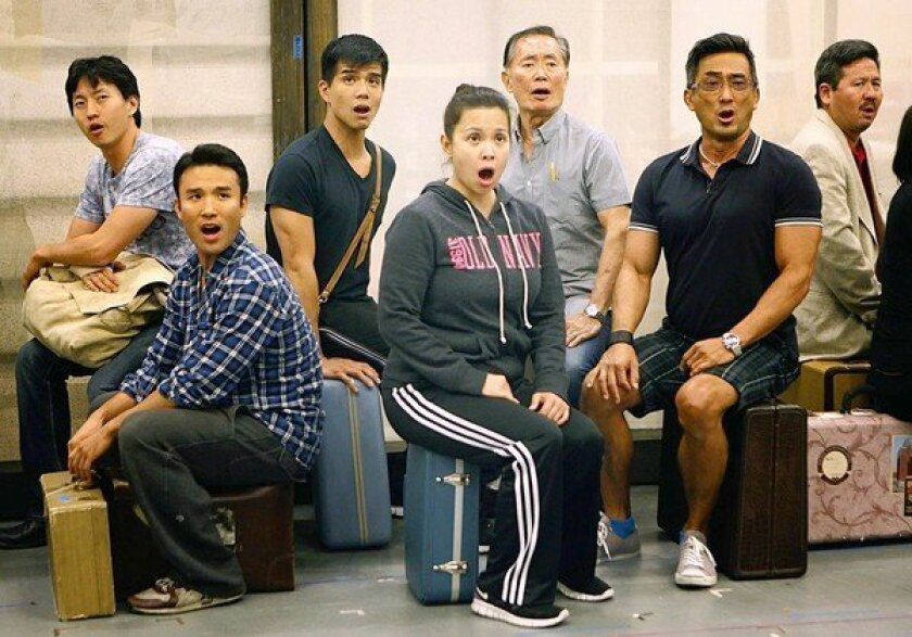 """The ensemble of """"Allegiance"""" rehearses at the Old Globe Theater rehearsal hall in San Diego. Together in the middle are the three lead actors: Telly Leung, left, Lea Salonga and George Takei."""