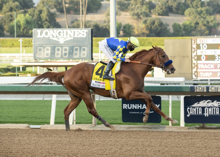 This photo provided by Benoit Photo shows Charlatan and jockey Mike Smith, right, winning the Grade I, $300,000 Malibu Stakes, Saturday, Dec. 26, 2020, at Santa Anita Park, Arcadia, Calif. (Benoit Photo via AP)