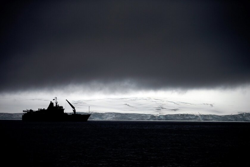 In this Jan. 25, 2015 photo, Chile's Navy ship Aquiles moves alongside the Hurd Peninsula, seen from Livingston Islands, part of the South Shetland Islands archipelago in Antarctica. This is also the place where a hole in the ozone layer, from man-made refrigerants and aerosols, parks for a couple months when sunlight creeps back to Antarctica in August. It triggers a chemical reaction that destroys ozone molecules, causing a hole that peaks in September and then closes with warmer weather in November. (AP Photo/Natacha Pisarenko)