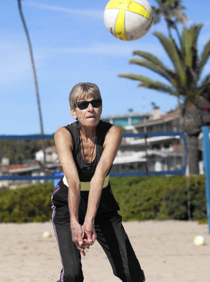 Lois Austin, 80, learned to play beach volleyball 60 years ago. She still plays three times a week.