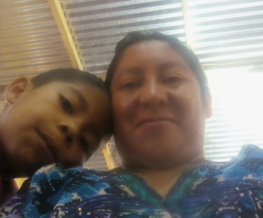 This 2018 photo provided by Beata Mariana de Jesus Mejia-Mejia shows her with her son Darwin Micheal Mejia in Quetzaltenango, Guatemala, before they left for the United States and crossed the border near San Luis, Ariz.