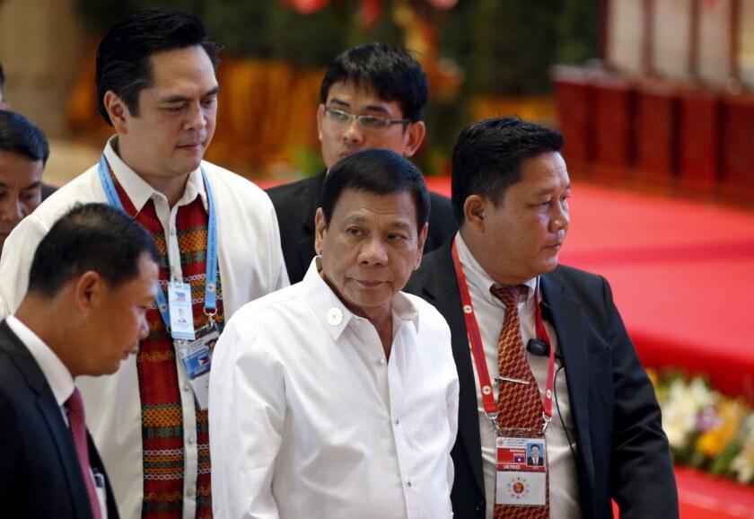 Philippine President Rodrigo Duterte, center, arrives at the venue of the Association of Southeast Asian Nations (ASEAN) Summit in Vientiane, Laos