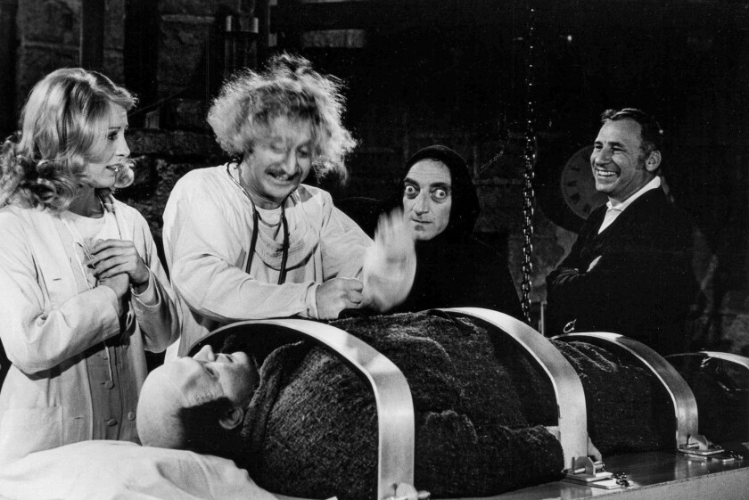 """March 27, 1974: On the set of the movie """"Young Frankenstein"""" are from left standing: Teri Garr, Gene"""