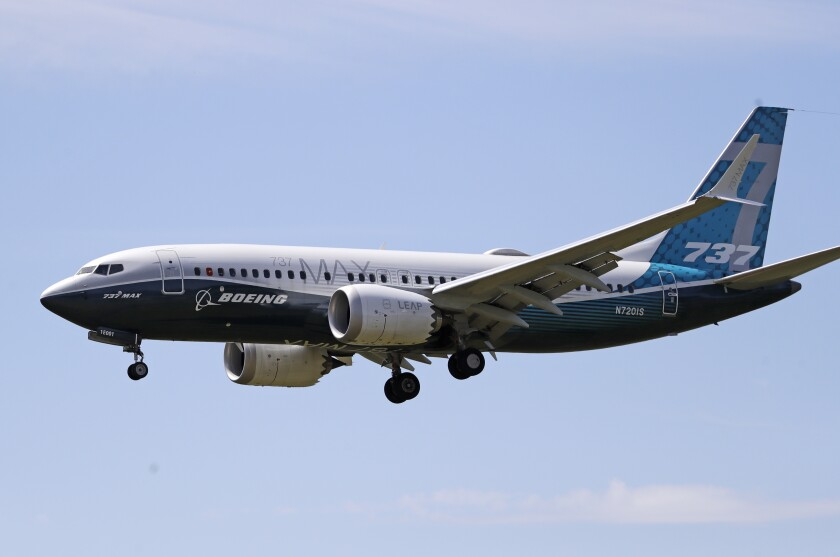 A Boeing 737 Max jet heads to Boeing Field in Seattle following a test flight on June 29.