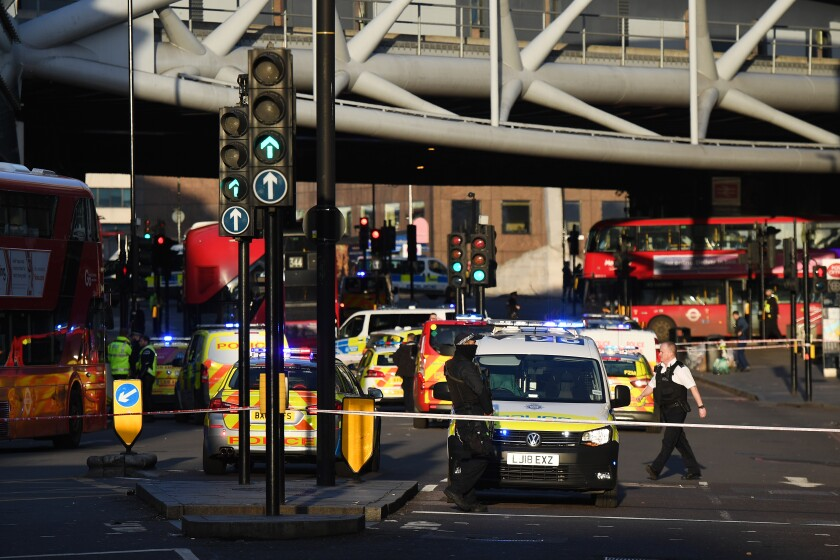Traffic is stopped behind a police cordon Friday near London Bridge