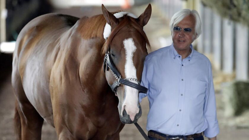 Trainer Bob Baffert walks Justify around the barn after they arrived in New York last month for the Belmont Stakes.