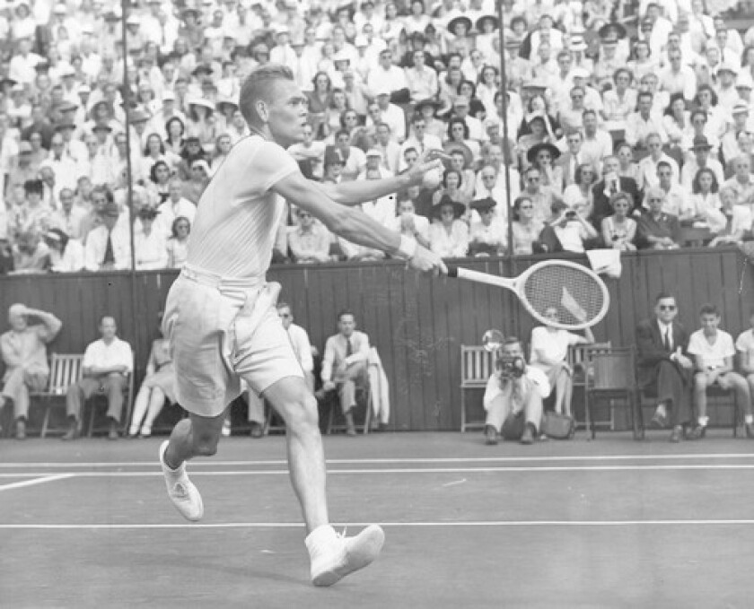 Jack Kramer smashes a powerful forehand stroke in a 1946 win over Ted Schroeder for the 1946 Pacific Southwest title. The two were doubles partners and close friends.