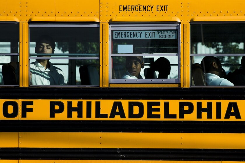 Students arrive for school Monday, Sept. 8, 2014, in Philadelphia. Philadelphia opened three new public high schools Monday in an effort to show the troubled district is still trying to innovate despite the specter of massive layoffs. (AP Photo/Matt Rourke)