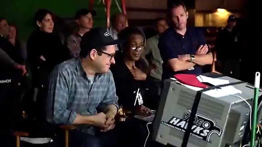Script supervisor Dawn Gilliam, center, with director JJ Abrams, left, on the set the of the 2009 fi