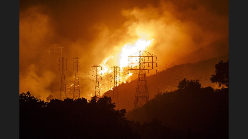 Flames whip around power lines during the Thomas fire in 2017, which was one of more than 2,000 fires caused by malfunctioning electrical equipment since 2014.
