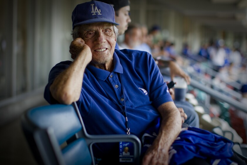 Legendary scout George Genovese, shown at Dodger Stadium in 2013, was hired by the Dodgers after the San Francisco Giants dismissed him in 1994.