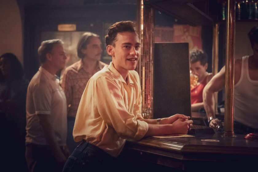 """Olly Alexander as Ritchie, a young gay character, in a bar in """"It's a Sin."""""""