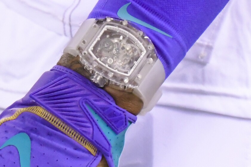 """FILE - In this Sept. 16, 2019, file photo, Cleveland Browns' Odell Beckham wears a Richard Mille watch during warm ups before an NFL football game against the New York Jets, in East Rutherford, N.J. Football fashion plate Odell Beckham Jr. has switched watches. The Browns polarizing wide receiver has partnered with Swedish watchmaker Daniel Wellington, which introduced him Wednesday, Sept. 18, 2019, as """"one of our new icons."""" Beckham caused a minor uproar last week by wearing a nearly $200,000 Richard Mille watch during Cleveland's home opener. (AP Photo/Bill Kostroun, File)"""