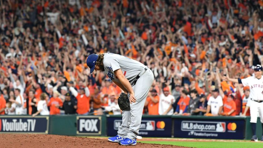 Clayton Kershaw reacts after giving up a three-run home run to the Astros' Yuli Gurriel during Game 5 of the 2017 World Series at Minute Maid Park.