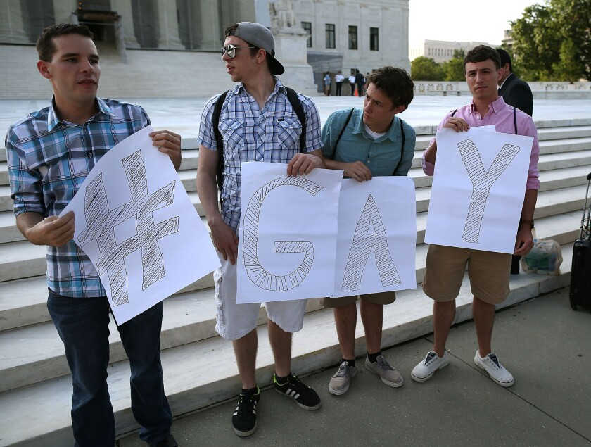 Gay rights activists gather in front of the U.S. Supreme Court on Wednesday.